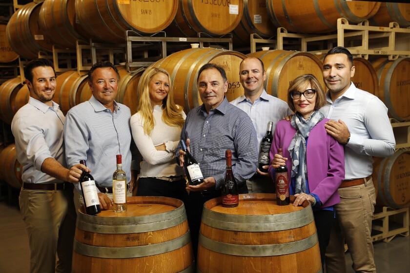 Chris Riboli, left, Steve Riboli, Lisa Riboli-Elzholz, Santo Riboli, Anthony Riboli, Cathy Colombatti and Dante Colombatti are part of the Riboli family making Stella Rosa wines at the historic San Antonio Winery near downtown Los Angeles.