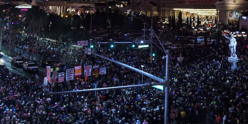 In front of Caesars Palace, Las Vegas Boulevard is transformed into a packed pedestrian mall on Jan. 1, 2016.  More than 330,000 visitors were expected.