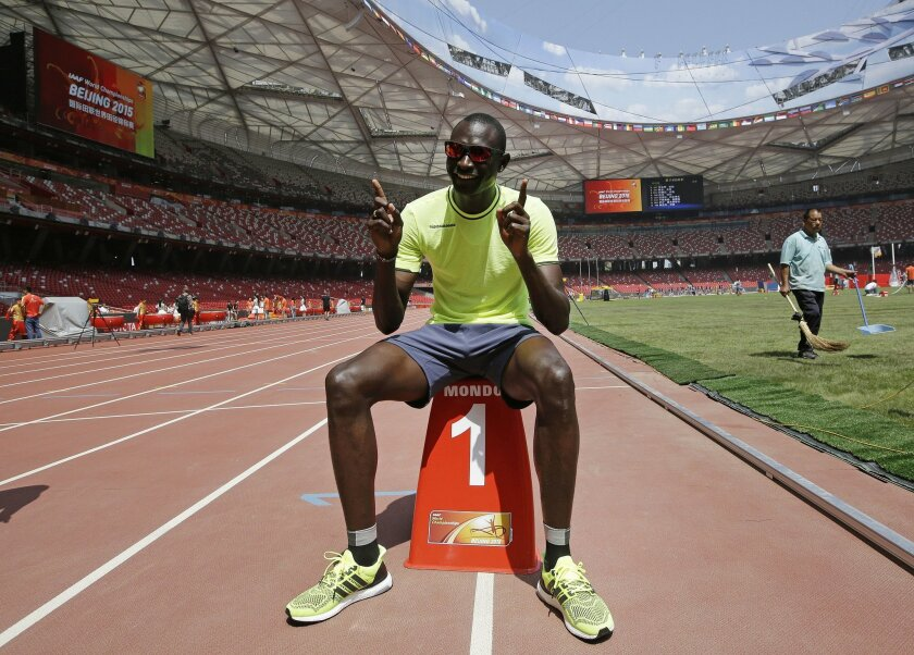 Kenya's David Lekuta Rudisha poses for a photo during a photo call at the Bird's Nest stadium in Beijing, Thursday Aug. 20, 2015. Final preparations are being made for the World Athletics Championships which get underway on Saturday Aug. 22. (AP Photo/Lee Jin-man)