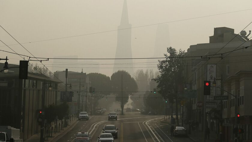 The Transamerica Pyramid is obscured by smoke and haze from wildfires Friday, Nov. 16, 2018, in San