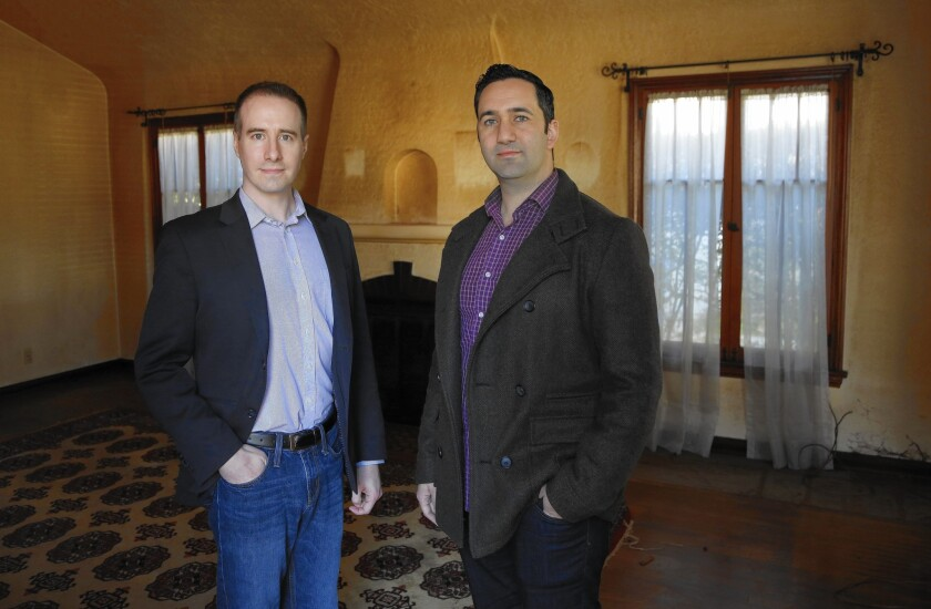 Jason Fritton, CEO of the crowdfunding platform Patch of Land, left, and David Berneman of Golden Bee Properties in one of the homes they plan to renovate.