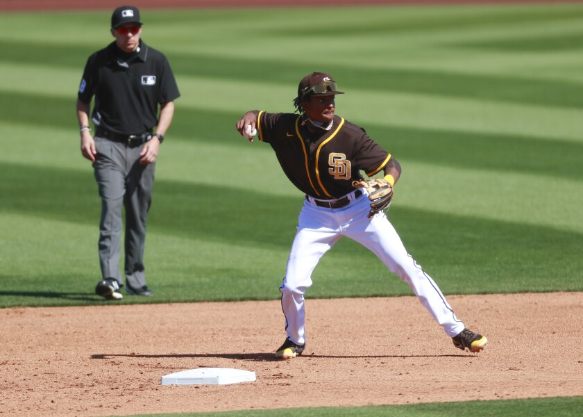 Padres prospect CJ Abrams turns a double play in a spring training game on Wednesday against the Milwaukee Brewers.