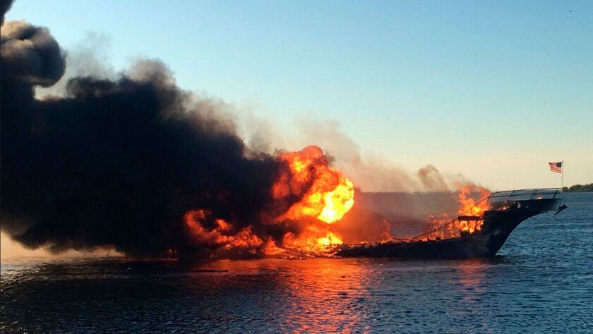 Flames engulf a shuttle boat Sunday in the Tampa Bay area.