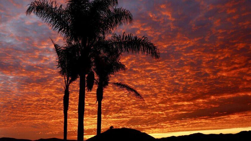 THOUSAND OAKS CA DECEMBER 3, 2018 -- Red sky sunrise in Thousand Oaks Monday morning, December 3, 2