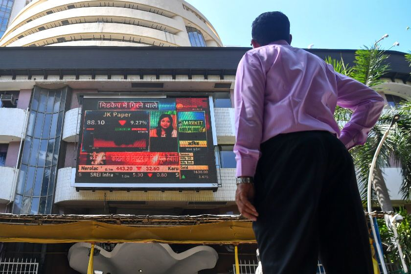 A man watches share prices on a digital display at the Bombay Stock Exchange in Mumbai, India.