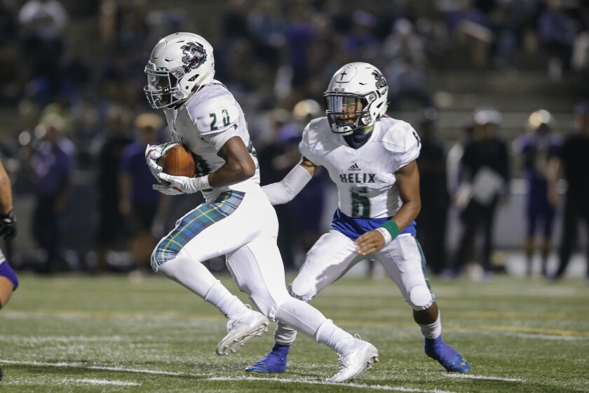 Helix running back Christian Washington (shown in an earlier game) rushed for 218 yards and four touchdowns in the Highlanders' win over Steele Canyon on Friday.