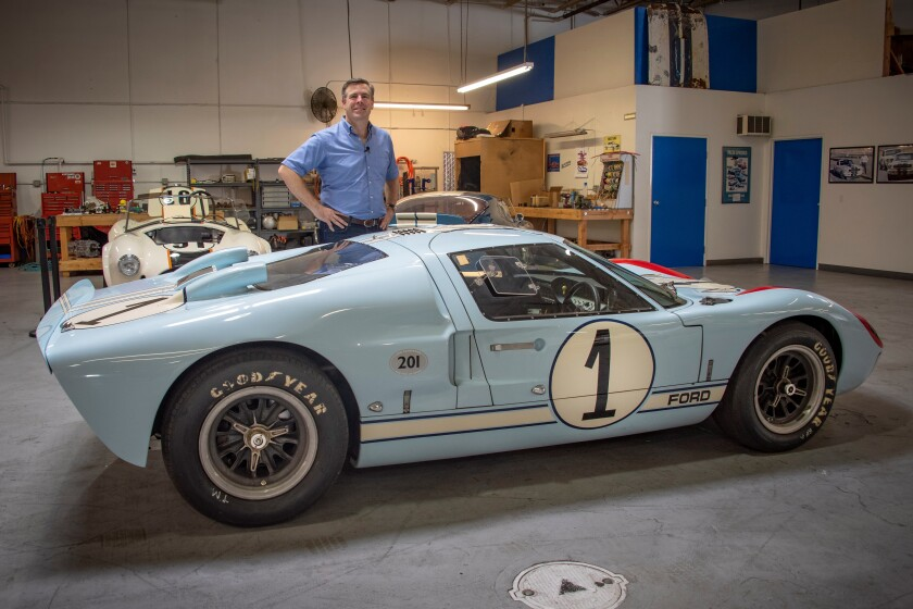 Aaron Shelby stands next to Ken Miles' Ford GT40.