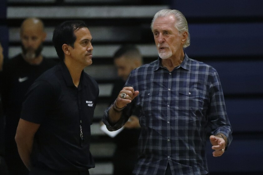 Heat coach Erik Spoelstra, left, talks with team president Pat Riley during training camp Oct. 1, 2019, in West Palm Beach.
