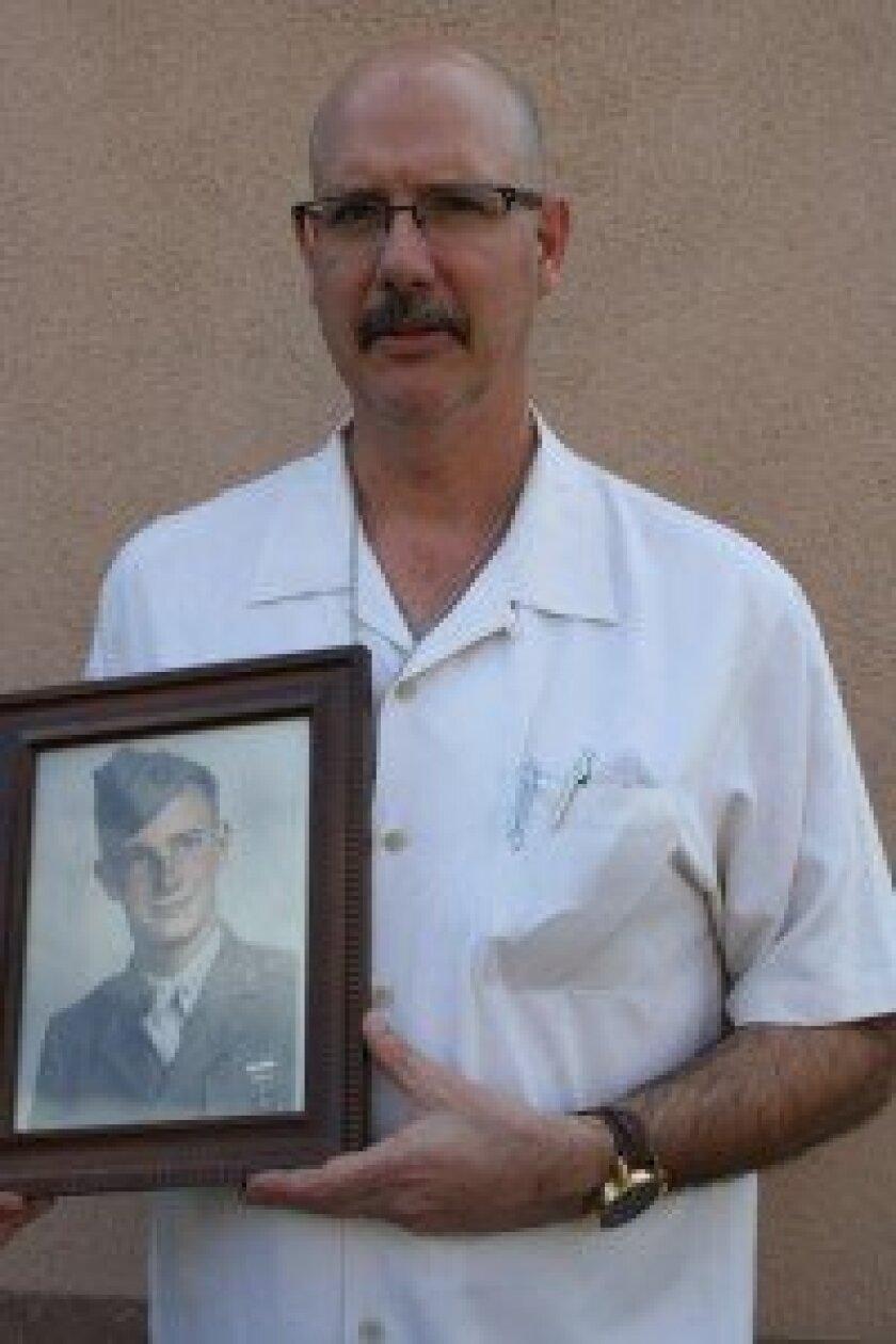 John Marsden holding a photo of his father Pfc. Robert Noel Marsden. Photos/Kristina Houck