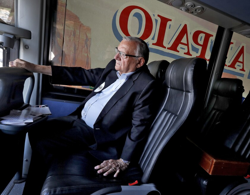 FILE - In this Aug. 23, 2018, file photo, U.S. Senate candidate and former Maricopa County Sheriff Joe Arpaio rides on his campaign bus in Phoenix. Arpaio's primary defeat in his bid to win back the sheriff's post in metro Phoenix marks what's likely to be the 88-year-old's last political campaign. (AP Photo/Matt York, File)