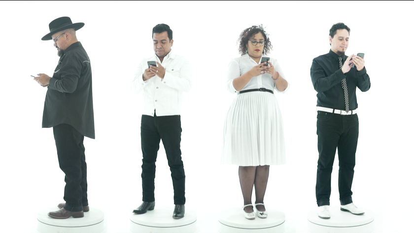"""La Santa Cecilia's new song, """"Winning,"""" is an indictment of the relentless pace of social media."""