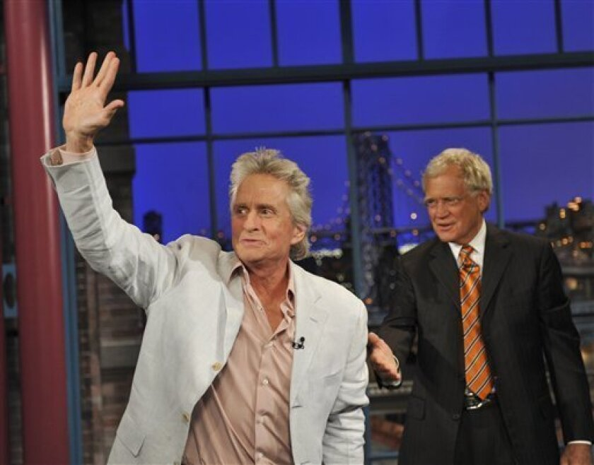"In this photo provided by CBS, Michael Douglas waves to the Late Show audience after a hug from host David Letterman during the Tuesday, Aug. 31, 2010 taping of the show in New York. Douglas said he faces an ""eight-week struggle"" against throat cancer but is optimistic about his chances for recovery. (AP Photo/CBS, John Paul Filo) MANDATORY CREDIT; NO SALES; NO ARCHIVE; NORTH AMERICAN USE ONLY"