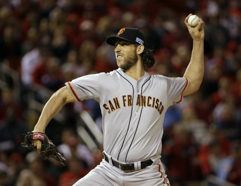 San Francisco Giants starting pitcher Madison Bumgarner throws during the first Game 1 of the National League baseball championship series against the St. Louis Cardinals Saturday, Oct. 11, 2014, in St. Louis. (AP Photo/David J. Phillip)