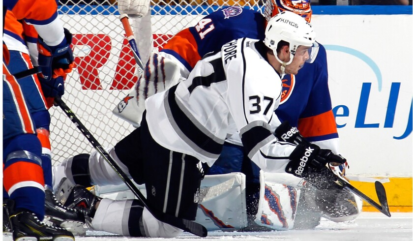 Kings center Nick Shore (37) slides to the ice after redirecting a shot by teammate Dustin Brown (not pictured) past Islanders goalie Jaroslav Halak in the second period Thursday night.