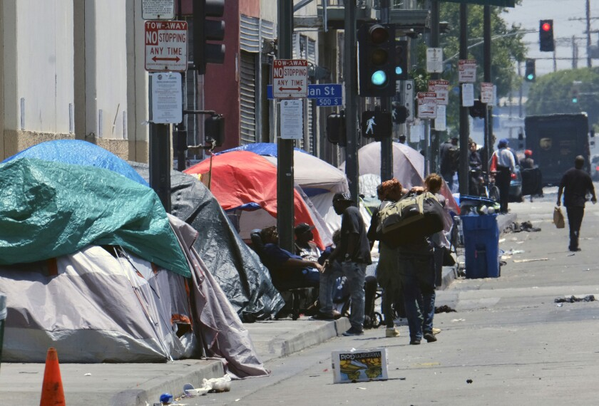 California governor signs bills to speed homeless shelters