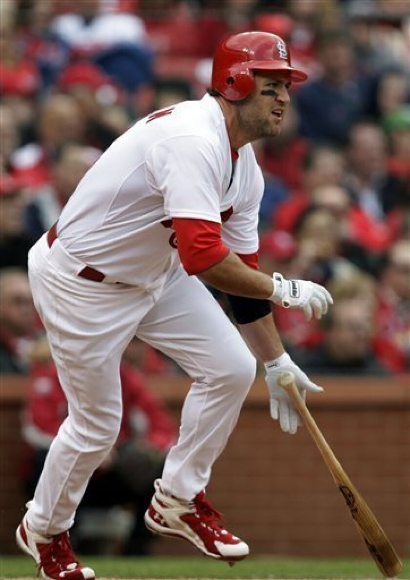 St. Louis Cardinals' Lance Berkman tosses the bat after connecting for a single, his second hit of the game, during the sixth inning of a baseball game against the San Diego Padres on opening day Thursday, March 31, 2011, in St. Louis. (AP Photo/Tom Gannam)