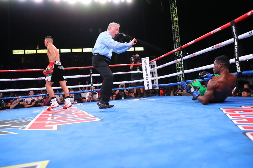Patrick Allotey tries to get up off the mat after being knocked down by Jaime Munguia.