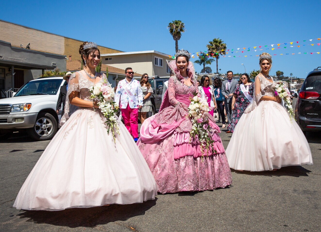 Festa Queen Jaquelyn Neves (center) and her court, Victoria Jorge (left) and Berlyn Balelo