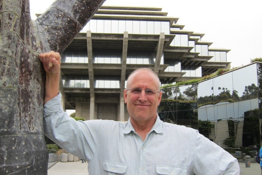 Dirk Sutro stands outside UCSD's landmark Geisel Library. Photo Dolores Davies