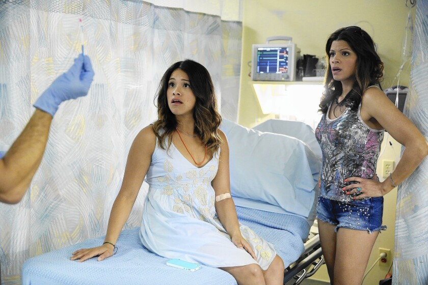 """Gina Rodriguez, left, stars as Jane and Andrea Navedo plays her mother, Xiomara, in the CW's """"Jane the Virgin."""""""