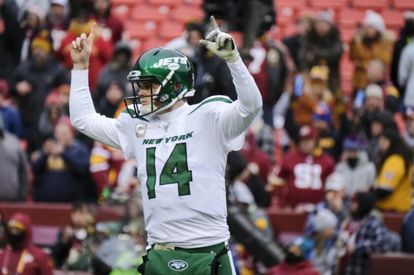 Jets quarterback Sam Darnold (14) celebrates a touchdown against the Redskins during a game Nov. 17.