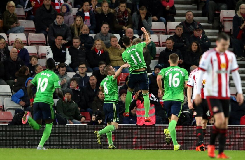 Southampton's Dusan Tadic, center top, celebrates his goal with his teammates during their English Premier League soccer match between Sunderland and Southampton at the Stadium of Light, Sunderland, England, Saturday, Nov. 7, 2015. (AP Photo/Scott Heppell)