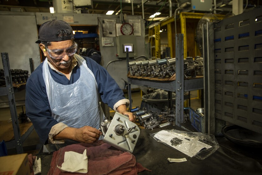 Gilberto Salazar cleans and preps brake hydro boosters for painting inside Motorcar Parts of America's world headquarters in Torrance.