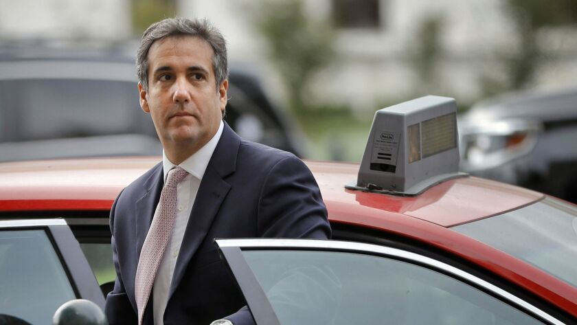 Michael Cohen, President Trump's former personal attorney, steps out of a cab during his arrival on Capitol Hill on Sept. 19, 2017.