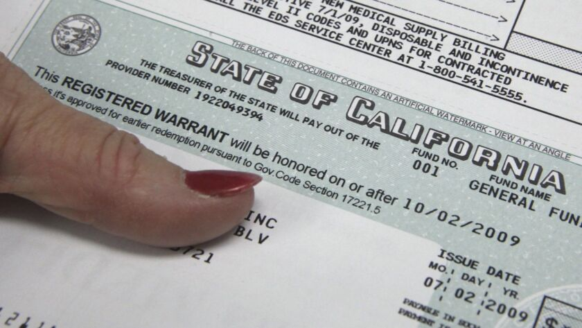 One of the first registered warrants is seen after printing at the Controller's office in Sacrament