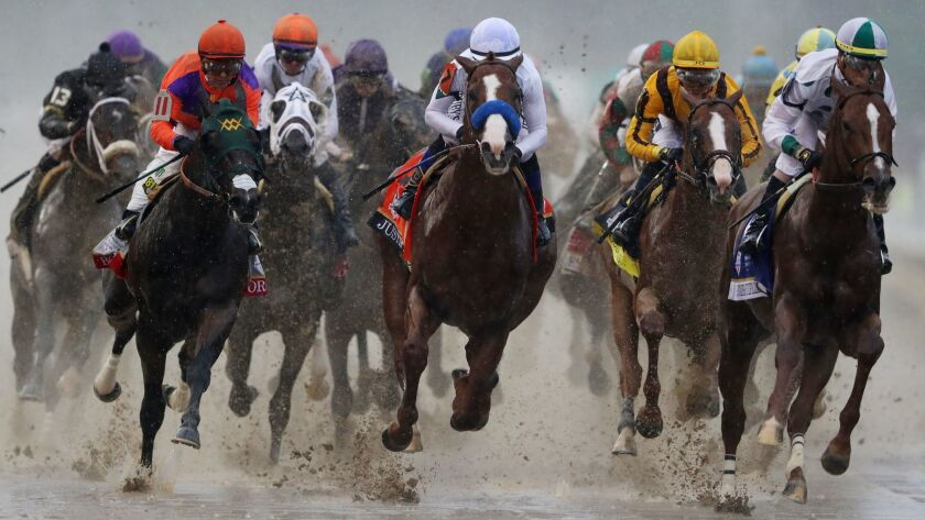 Jockey Victor Espinoza and Bolt d'Oro, No. 11 at front-left, rushed to the front early but faded late to finish 12th during the Kentucky Derby on Saturday at Churchill Downs in Louisville, Ky. The horse is owned and trained by El Cajon native Mick Ruis.