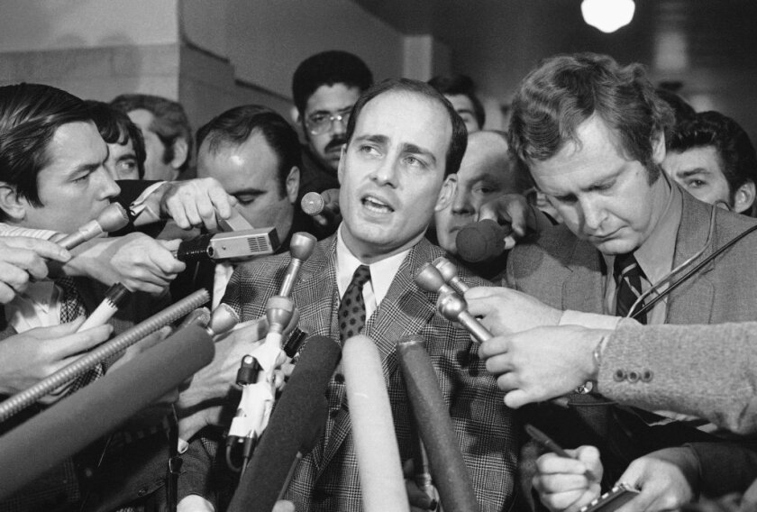 Chief prosecutor Vincent Bugliosi speaks to reporters in 1971 after Charles Manson and three followers were found guilty of multiple murders.