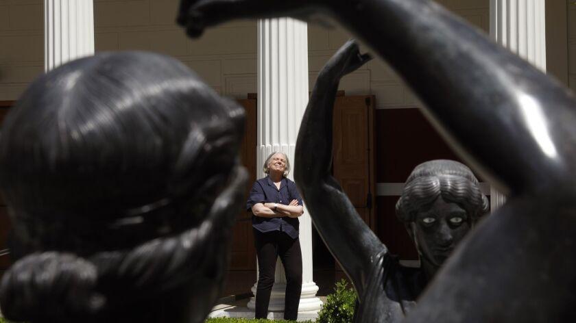 MALIBU, CA - AUGUST 23, 2018 - New York theater director Anne Bogart rests near statues that symboli