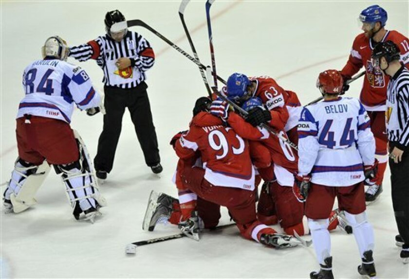Czech players celebrate scoring their first goal during their qualification round group E Hockey World Championships match against Russia in Bratislava, Slovakia, Sunday, May 8, 2011. Russian goalkeeper Konstantin Barulin is seen on the left, Nikolai Belov of the Russian team on the right. (AP Phot
