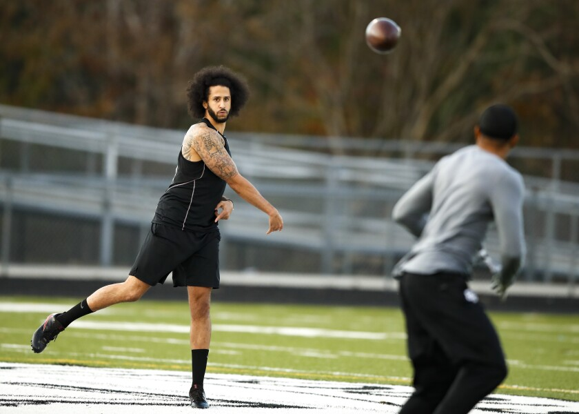 Colin Kaepernick throws a pass during a workout session.