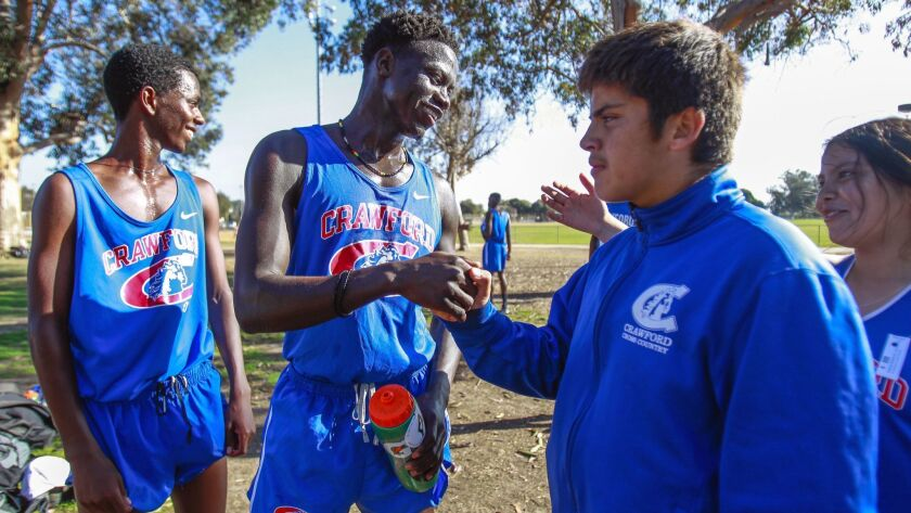 SAN DIEGO, October 30, 2018 | Crawford High School cross country runner Nader Ali, center, who is fr