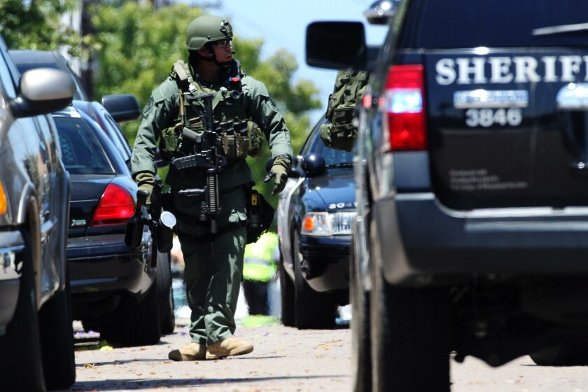 San Diego County Sheriff's SWAT team took a man in to custody after a brief standoff in Imperial Beach.