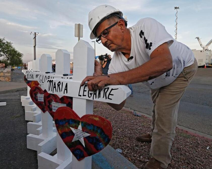 Greg Zanis with Crosses for Losses signs a few crosses for each victim he has for the make shift memorial after the mass shooting that happened at a Walmart in El Paso, Texas. EFE/EPA/Larry W. Smith/File