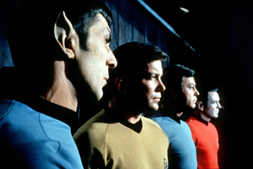 """FILE- This undated file photo shows actors in the TV series """"Star Trek,"""" from left, Leonard Nimoy as Commander Spock, William Shatner as Captain Kirk, DeForest Kelley as Doctor McCoy and James Doohan as Commander Scott. Nimoy, famous for playing officer Mr. Spock in """"Star Trek"""" died Friday, Feb. 27, 2015 in Los Angeles of end-stage chronic obstructive pulmonary disease. He was 83. (AP Photo/Paramount Television ,File)"""