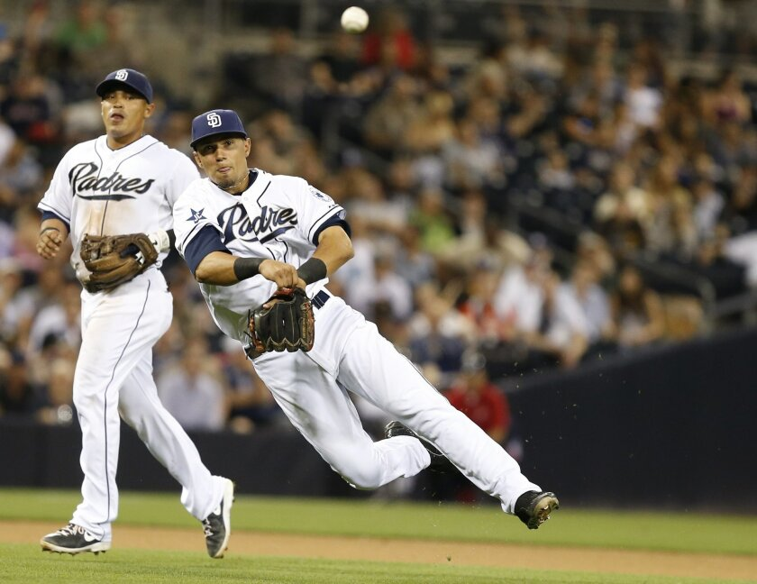Padres third baseman Jace Peterson fires a throw to first but can not get Arizona Diamondbacks' Aaron Hill who collected his second hit of the game during the ninth inning of a baseball game won 2-0 by the Diamondbacks Friday, May 2, 2014, in San Diego.