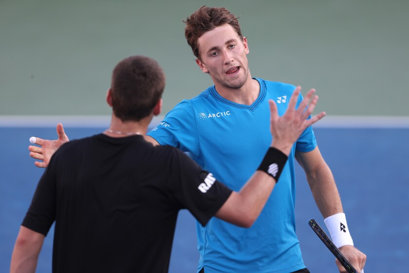 Casper Ruud of Norway shakes hands with Cameron Norrie of Great Britain after defeating him (6-0, 6-2) in the Finals match of the San Diego Open