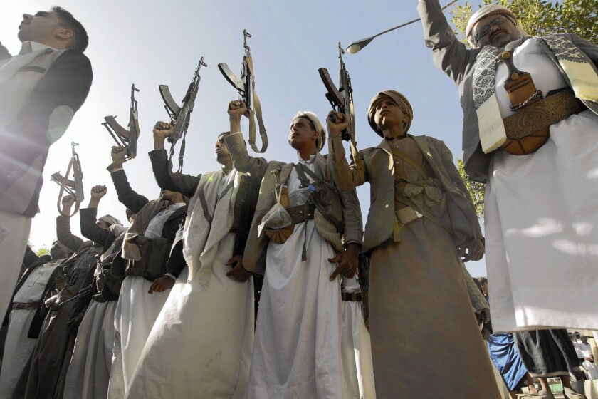 """Tribal gunmen in Sana, Yemen, on April 16 protest a U.N. arms embargo against Houthi rebels. Saudi-led airstrikes in Yemen have hit """"dozens of public buildings,"""" including schools and mosques, the U.N. said."""