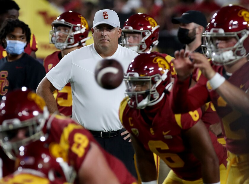 USC coach Clay Helton watches the Trojans warm up before Saturday's loss to Stanford.
