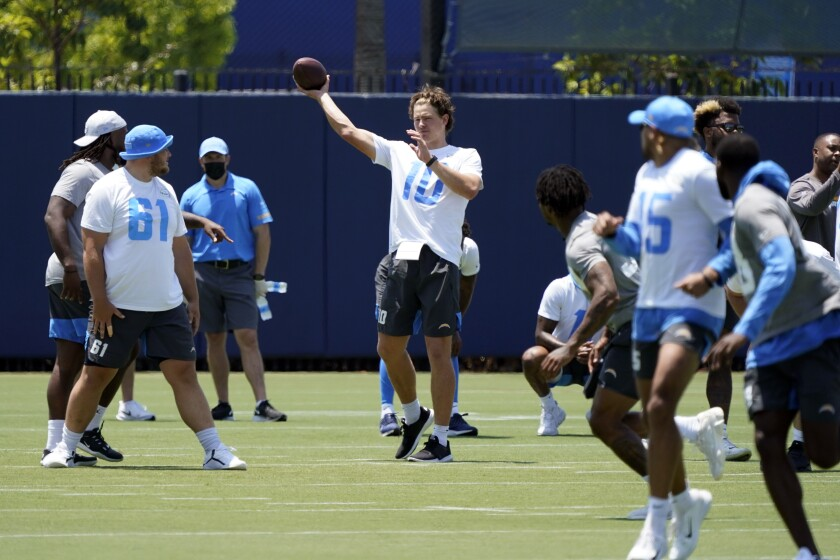 Chargers quarterback Justin Herbert throws during organized team activities.