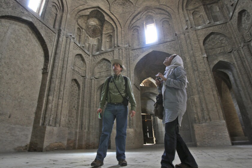 Tourists in 2011 visit the Iranian city of Isfahan, about 230 miles south of Tehran.