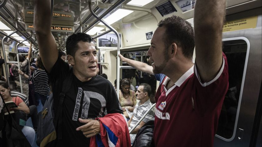 São Paulo, Brazil. Teoscar Mata, 29 and Luis Baena, 42, walking by the first time in their lifes in