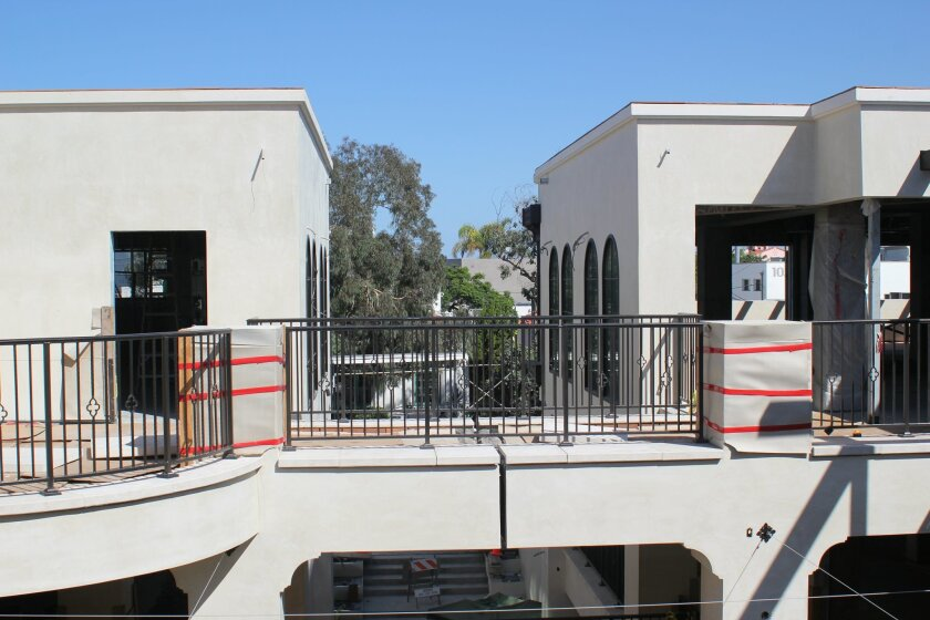 A walkway connects two of the main tenant spaces on La Plaza's third floor. Catania restaurant is scheduled to open in the space at right in January 2015.