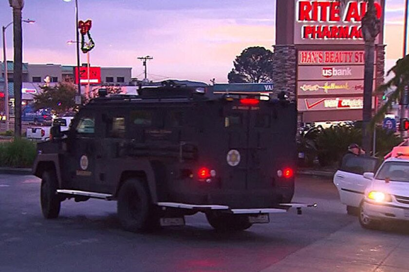 A Los Angeles County Sheriff's Department vehicle is seen at a shopping center in La Crescenta where a man was barricaded inside a Verizon store.