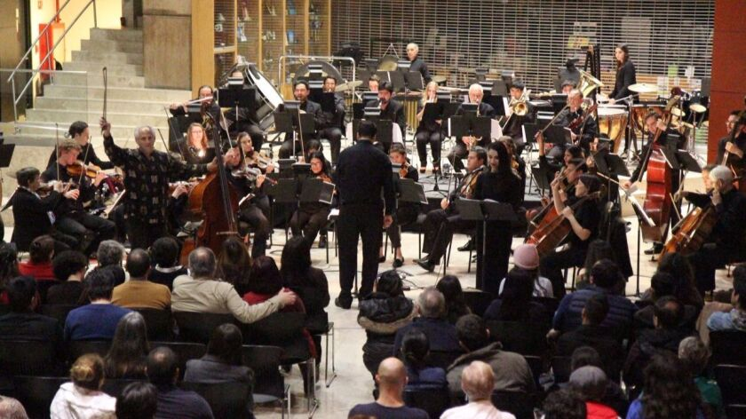 """Bassist Barry Green (at left, with his bow in the air) is shown at March 2 Tijuana concert of """"Anna's Priomise."""" A second performance will take place Tuesday at Point Loma Nazarene University."""