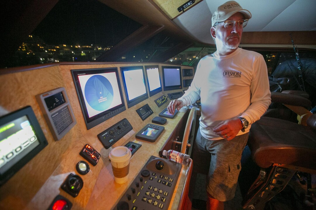 Captain Cory Grodske, captain of the 75-foot C-Bandit II from San Diego, started up the electronics on the boat before heading out for the second day of fishing. They caught and released one black marlin.