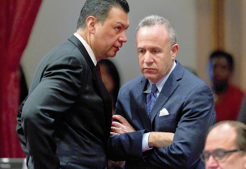 State Senate President Pro Tem Darrell Steinberg (D-Sacramento), right, and Sen. Alex Padilla (D-Pacoima) confer after a bipartisan vote to suspend three Democratic senators. The three -- Ronald Calderon, Leland Yee and Roderick Wright -- will continue to be paid.